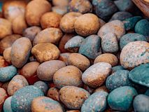 Ornamental stones in vintage tone color. Stack of colorful stones Vintage tone for decoration in the natural garden Royalty Free Stock Photo
