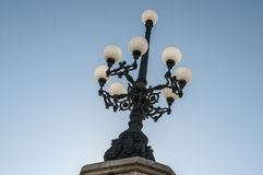 Ornamental street lamp. Beautiful street lamp against blue sky in Valencia, Spain Royalty Free Stock Image