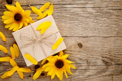 Ornamental sunflowers and gift box Royalty Free Stock Photo