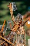 Ornamental support of branches used for glasses and bottle Royalty Free Stock Images
