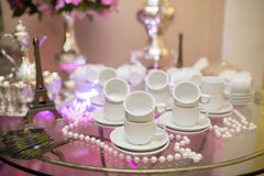 Ornamental tea set on glass table Stock Photo