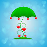 Ornamental umbrella on blue background Royalty Free Stock Images