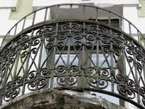 Ornamental vintage black peeling paint round shape balkony grid