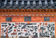 Ornamental wall fragment. Fragment of asian ornamental wall with roof tiles Stock Image