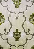 Ornamental wallpaper. Pattern of white-green ornamental floral wallpaper royalty free stock photos