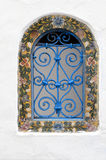 Ornamental window. Blue iron  ornamental window typical in norht Africa, Tunisia or Morroco Royalty Free Stock Photos