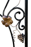Ornamental Wrought Iron. Closeup of a section of decorative black wrought iron, with ornamental leaf and grapes.  Isolated on a white background Royalty Free Stock Image