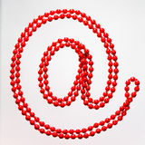 Ornamentation. Red beads are in the form `@` symbol Stock Photo