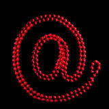 Ornamentation. Red beads are in the form `@` symbol Stock Photography