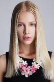 Ornamentation. Snazzy Blond Woman with Floral Necklace. Ornamentation. Stylish Blond Woman with Floral Necklace Stock Photo