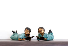 Ornamented Bronze figures of  two chidren. Reading books Royalty Free Stock Photography