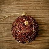 Ornamented christmas ball with a retro effect Stock Photos