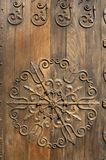 Ornamented door. Ornamental ironwork on old oak door Royalty Free Stock Photo