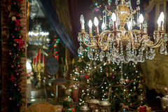 Ornamented gold chandelier of christmas decorated home interior Stock Photo