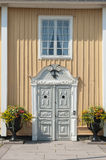 Ornamented grey door Norrtalje Stock Photo