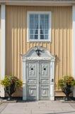 Ornamented grey door Norrtalje Stock Photo