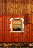 Ornamented rustic window. A view of the ornamented window of a  wooden rustic cottage in Lithuania Royalty Free Stock Photos