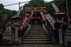 Ornamented sanctuary with statues of the Japanese fox Kitsune. Fushimi Inari Shrine, Kyoto, Japan Stock Photography