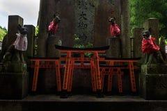 Ornamented sanctuary with statues of the Japanese fox Kitsune. Fushimi Inari Shrine, Kyoto, Japan Royalty Free Stock Photography