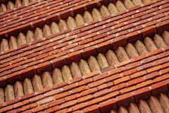 Ornamented wall from red and yellow bricks Stock Photos