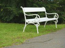Ornamented white iron park bench Stock Image