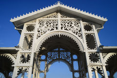 Ornamented white wooden arbor Royalty Free Stock Image