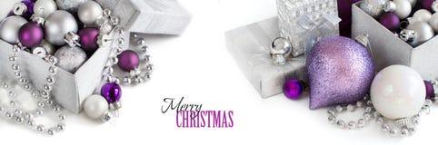 Ornamenti d'argento e porpora di Natale Immagine Stock Libera da Diritti