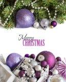 Ornamenti d'argento e porpora di Natale Immagini Stock Libere da Diritti