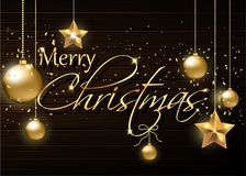 Ornamenti dell'oro su fondo di legno Cartolina di Natale Immagini Stock