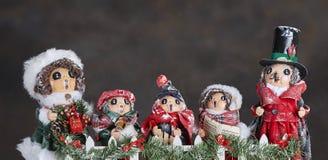 Ornamenti di Carol Singers Fotografia Stock