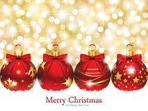 Ornamenti di Natale davanti alle luci Defocused Fotografia Stock