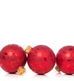 Ornamenti di Natale su fondo bianco con lo spazio della copia Immagine Stock