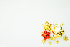 Ornamenti e decorazioni di Natale Stelle dorate e stelle rosse Immagine Stock