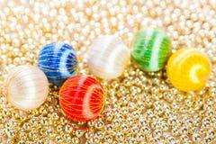 Ornamenti e perle di Natale Immagine Stock