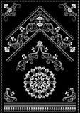 Ornamenti ed angolo bianchi di calligrafia su fondo nero Fotografia Stock