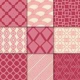 Ornamenti geometrici rosso ciliegia e beige Accumulazione dei reticoli senza giunte Immagini Stock Libere da Diritti