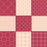 Ornamenti geometrici rosso ciliegia e beige Accumulazione dei reticoli senza giunte Immagini Stock