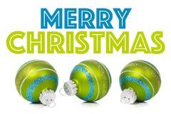 Ornamenti verdi di Natale su fondo bianco con lo spazio della copia Immagine Stock