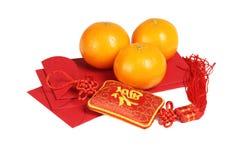 Ornamento chino del Año Nuevo y mandarinas - carácter chino que significa fortuna