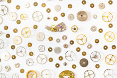Ornamento dai vari pezzi di ricambio anziani dell'orologio Fotografia Stock