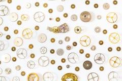 Ornamento das várias peças sobresselentes idosas do relógio Fotografia de Stock