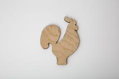 Ornamento de madera del gallo de la Navidad en blanco Imagen de archivo libre de regalías