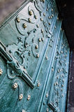 ornamento decorativos nas portas à igreja Imagem de Stock