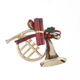 Ornamento del corno di natale dell'oro Fotografia Stock