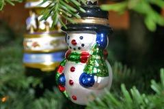 Ornamento del muñeco de nieve Imágenes de archivo libres de regalías