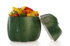 Ornamento di ceramica del pepe con peperone dolce tagliato Fotografia Stock