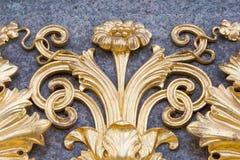 Ornamento di metallo floreale dorato Fotografia Stock
