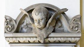 Ornamento di pietra (testa del bambino) Immagine Stock