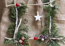 Ornamento do Natal com plantas naturais fotografia de stock