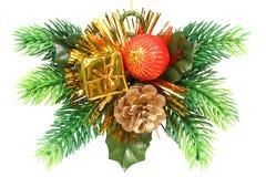 Ornamento do Natal sob a forma de uma filial com presente Fotografia de Stock Royalty Free